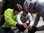 How many riders does it take to refit a tyre?
